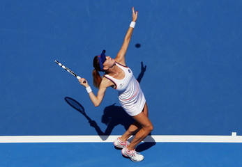 Agnieszka Radwanska of Poland serves to Anastasia Pavlyuchenkova of Russia during their women's singles match at the Australian Open 2014 tennis tournament in Melbourne