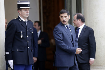 French President Francois Hollande accompanies Qatar's Prime Minister and Interior Minister Sheikh Abdullah bin Nasser bin Khalifa Al Thani after a meeting at the Elysee Palace in Paris