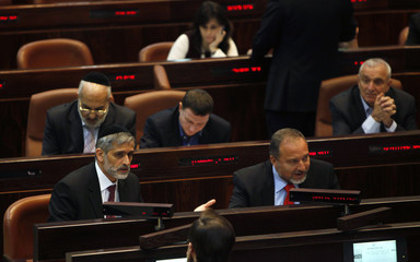 Israel's Foreign Minister Lieberman and Interior Minister Yishai attend a session of the Israeli parliament in Jerusalem