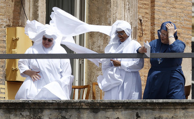 Nuns attend a mass marking the end of the Year for Priests celebrated by Pope Benedict XVI in St. Peter's Square at the Vatican
