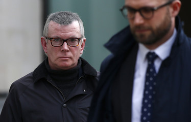 Banker, Colin Birmingham leaves Westminster Magistrates court in London