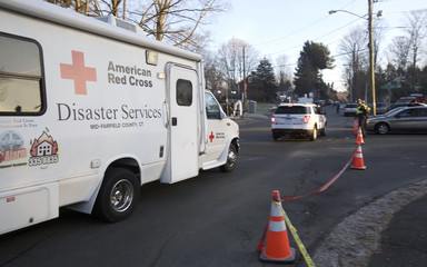 American Red Cross vehicles arrive at Sandy Hook Volunteer Fire Department, near Sandy Hook Elementary School in Newtown