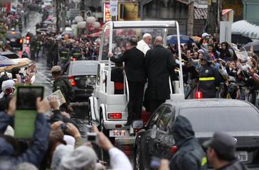 Pope Francis greets faithful as he rides through the streets of Aparecida do Norte