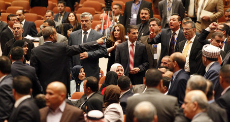 Members of the newly elected Iraqi parliament gesture at each other after an argument broke out at the parliament headquarters in Baghdad