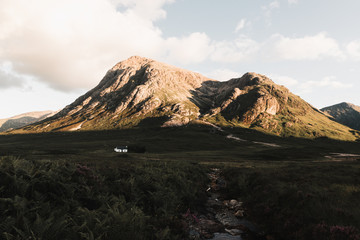 Cabin in the scottish highlands at sunset