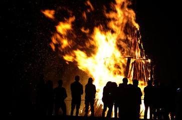 People attend a party held during the night of the San Juan bonfire on the beach of Playa de Poniente in Gijon