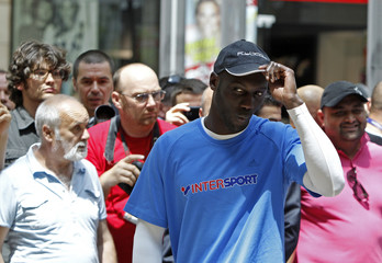 IBF Super Middleweight challenger Mendy of France arrives for a public training in Bucharest