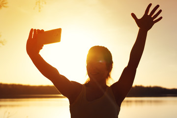 Young happy girl making selfie picture outdoors