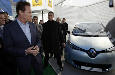Former California Governor and R20 Founding Chair Schwarzenegger looks at a vehicle on the opening day of the 82nd Geneva Auto Show
