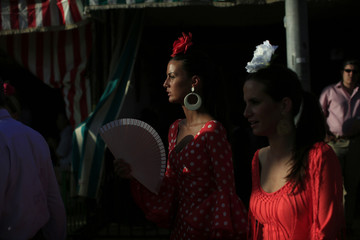 Women wearing typical Sevillana outfits are seen during the traditional Feria de Abril in Seville