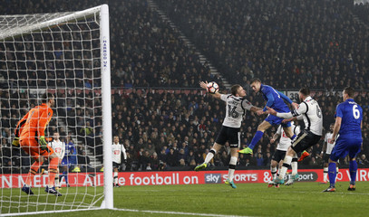Leicester City's Jamie Vardy heads at goal
