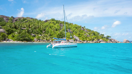 yacht in a bay in the Seychelles, tropical landscape with yacht in the ocean