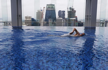 Fitness coach Peter Yeoman swims in the pool of Gravity health and fitness club in Singapore's central business district