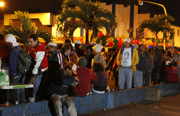 Homeless people line up to receive food during an event held to celebrate Christmas with the homeless in San Jose