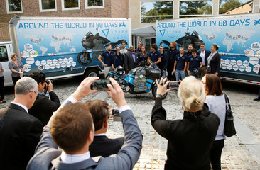Students who built world's first long distance electric motorcycle Storm Eindhoven have photograph taken during a demonstration at Royal Netherlands Embassy in Washington