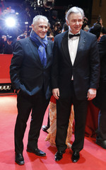 """Berlin mayor Wowereit and his partner Kubicki arrive on red carpet for the screening of the movie Yi Dai Zong Shi, """"The Grandmaster"""" at the 63rd Berlinale International Film Festival in Berlin"""