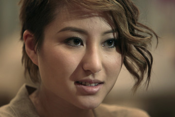 Florinda Ho speakS to reporters at her home in Hong Kong