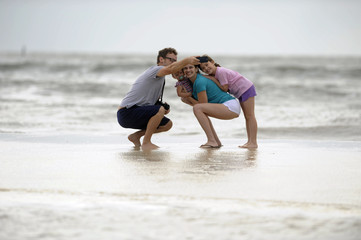 The Bernacchi family takes a photo along the beach as Hurricane Isaac approaches Gulfport