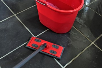 An Image of cleaning a floor