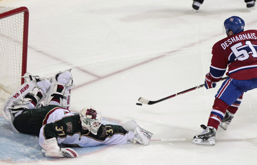 Montreal Canadiens' Desharnais scores on Minnesota Wild goalie Harding during NHL overtime shootout hockey action in Montreal