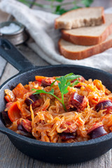 Cabbage stew with grilled sausage - traditional dish of german cuisine, Selective focus