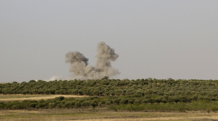 Smoke rises from what activists say was an airstrike by forces loyal to Syria's President Assad in Idlib
