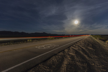 Wall Murals Route 66 Route 66 sign with full moon and streaking train in the California Mojave desert.