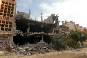 Buildings damaged during clashes between military forces loyal to Libya's eastern government and the Shura Council of Libyan Revolutionaries are seen in Benghazi