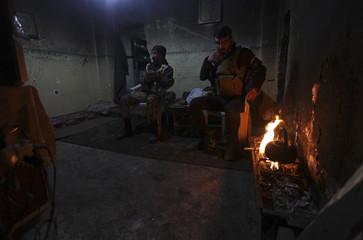 Free Syrian Army fighters rest while preparing tea in Deir al-Zor, eastern Syria