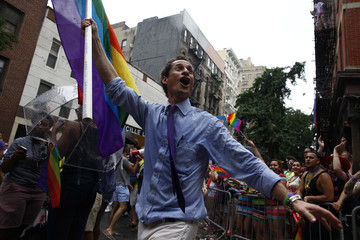 New York mayoral candidate Anthony Weiner marches in the Gay Pride Parade in New York