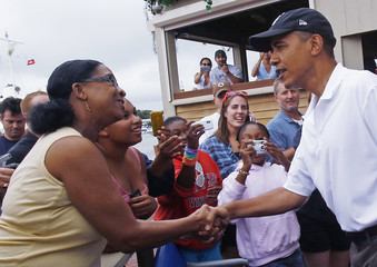 U.S. President Barack Obama greets guests as he arrives for lunch at Nancy's Restaurant in Martha's Vineyard in Oak Bluffs