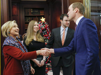 Britain's Prince William, Duke of Cambridge shakes hands with former U.S. Secretary of State Hillary Rodham Clinton at British Consul General's Residence in New York