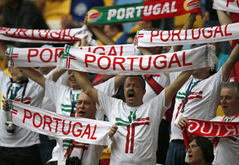 Portugal team supporters cheer before the start of their Group B Euro 2012 soccer match against Germany in Lviv