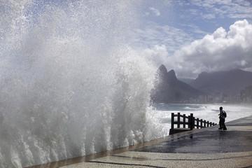 Students watch the waves at Arpoador Beach in Rio de Janeiro