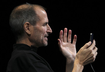 Apple CEO Steve Jobs demonstrates the new iPhone 4, during his appearance at the Apple Worldwide Developers Conference in San Francisco