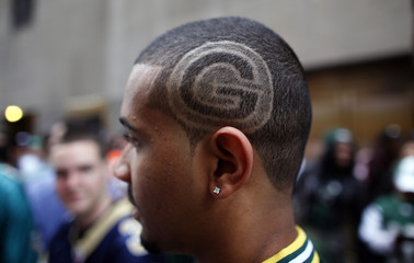 Green Bay Packers fan with the team's logo shaved into his hair, waits outside Radio City Music Hall before the 2011 NFL football Draft in New York