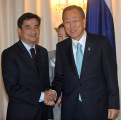 Thai Prime Minister Abhisit shakes hands with U.N. Secretary-General Ban during Ban's visit to the Government House in Bangkok
