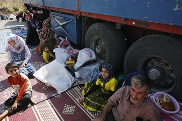 Civilians rest in the Bab Al-Salam refugee camp in Azaz