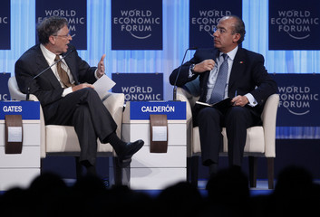 Microsoft founder Gates talks to Mexico President Calderon addresses a session at the World Economic Forum (WEF) in Davos