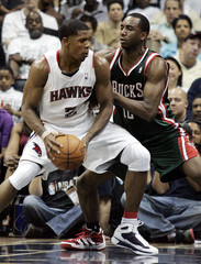 Atlanta Hawks guard JoeJohnson drives to the basket against  Milwaukee Bucks Luc Richard Mbah a Moute in the first round of NBA basketball action playoffs in Atlanta