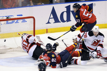 Florida Panthers' Goc scores the game tieing goal on New Jersey Devils' Brodeur during their NHL Eastern Conference quarter-final playoff hockey game in Sunrise