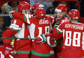 Belarus' players celebrate a goal against Sweden during their 2013 IIHF Ice Hockey World Championship preliminary round match at the Globe Arena in Stockholm