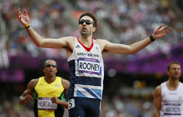 Britain's Martyn Rooney reacts after his second place finish in heat 7 during round 1 of the men's 400m heats at the London 2012 Olympic Games at the Olympic Stadium