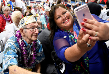Pearl Harbor survivor Milton Mapou poses for a picture before ceremonies honoring the 75th anniversary of the attack on Pearl Harbor at Kilo Pier on Joint Base Pearl Harbor - Hickam in Honolulu