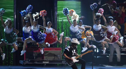 """Brad Paisley is accompanied by cheerleaders as he performs """"Country Nation"""" at the 49th Annual Country Music Association Awards in Nashville"""