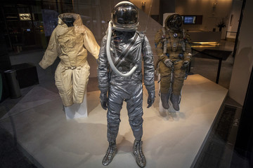 A Mercury era Space Suit is displayed with a Soviet full pressure Strizh Rescue Space Suit as part of the upcoming Space History Sale at Bonham's auction house in New York