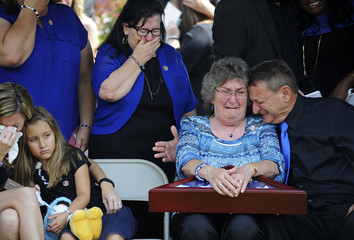 Family members of Baton Rouge Sheriff deputy Brad Garafola mourn during his funeral at the Istrouma Baptist Church in Baton Rouge