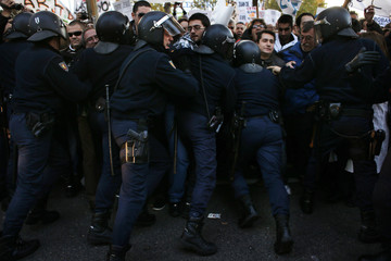 Demonstrators are pushed back by Spanish riot police during a protest in favour of the public health system in Madrid
