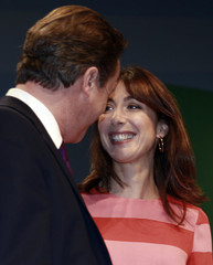 Britain's Prime Minister David Cameron is joined by his wife Samantha after his keynote speech on the final day of the Conservative Party conference in Manchester