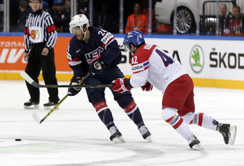 Koukal of the Czech Republic fights for the puck with Redmond of the U.S. during their Ice Hockey World Championship third-place game at the O2 arena in Prague